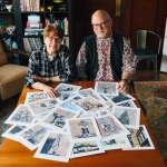 Lyn-and-Stephen-at-table-with-prints