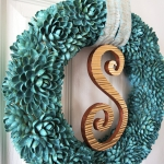 Pistachio-Flower-Wreath-with-Copper-Monogram